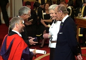 Dr Lawrence Goldman and Dr John Hood receive the award from Her Majesty The Queen and His Royal Highness The Duke of Edinburgh